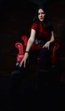 Kvinnan bleknar in i mörkret Royaltyfria Bilder