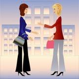 Kvinnan för affär två talar Arkivbild