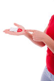 Kvinnan förhindrar med kondomar Royaltyfria Foton