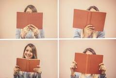 Kvinnan förlägger hennes armar på hennes varv och öppnar boken för att läsa arkivbilder
