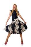 Kvinnan i den svarta blom- klänningen som isoleras på vit Fotografering för Bildbyråer