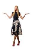 Kvinnan i den svarta blom- klänningen som isoleras på vit Arkivfoto