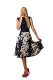 Kvinnan i den svarta blom- klänningen som isoleras på vit Royaltyfri Bild