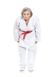 Kvinnan i karate poserar Arkivbilder