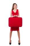 Kvinnan i röd klänning och loppet case isolerat Fotografering för Bildbyråer