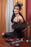 Kvinnan i strikt kläder i en retro stil. Royaltyfria Foton