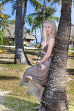 Kvinnan med en rose Fotografering för Bildbyråer
