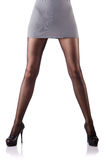 Kvinnan med högväxt lägger benen på ryggen isolerat Royaltyfria Bilder
