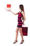 Kvinnan med shopping hänger lös Arkivbild
