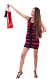 Kvinnan med shopping hänger lös Royaltyfri Bild