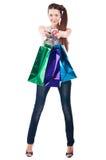 Kvinnan med shopping hänger lös Royaltyfria Bilder