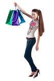 Kvinnan med shopping hänger lös Fotografering för Bildbyråer
