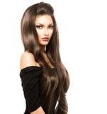 Kvinnan med skinande slätar brunt hår Royaltyfri Bild