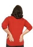 Kvinnan med strängt tillbaka smärtar isolerat Fotografering för Bildbyråer