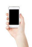Kvinnan räcker hållande smartphone Royaltyfri Bild