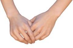 Kvinnan rymmer henne händer tillsammans Royaltyfri Foto