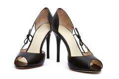 Kvinnan skor Arkivbild