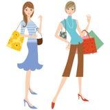 Kvinnan som gör shopping Arkivfoton