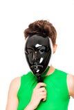 Kvinnan stängde den glansiga svarta maskeringen Arkivfoto