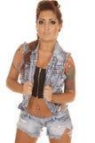 Kvinnan tatuerar att vända mot för grov bomullstvillväst Royaltyfria Bilder