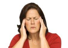 Kvinnan under sinnesrörelsespänning visar huvudvärk Royaltyfri Fotografi