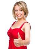 Kvinnan visar tummen övre gest Royaltyfri Fotografi