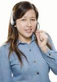 Kvinnaoperatör med hörlurar med mikrofon Fotografering för Bildbyråer