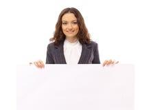 Kvinnapresents med ett blankt vitt bräde Fotografering för Bildbyråer