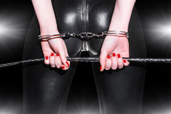 Kvinnarövcloseup i latexcatsuit Fotografering för Bildbyråer