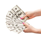 Kvinnas händer som rymmer 100 US dollarsedlar Royaltyfri Bild