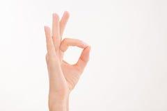 Kvinnas hand som uttrycker framgång Royaltyfri Foto