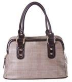 Kvinnas handväska på en bakgrund Royaltyfria Foton