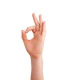 Kvinnas isolerat tecken för godkännande för handshowind Royaltyfri Fotografi