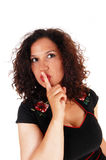 Kvinnawhitfinger över mun Arkivbild