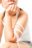 Kvinnlig arm med måttband Royaltyfri Foto