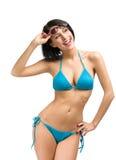 Kvinnlig bärande bikini och solglasögon royaltyfria bilder