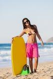 Kvinnlig bodyboarder Arkivbild