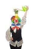 Kvinnlig clown med blommor Royaltyfri Foto