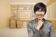 Kvinnlig för blandat lopp i rum med teckningen av underhållningenheten arkivbilder
