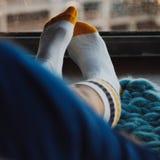 Kvinnlig fot i sockor Royaltyfri Foto