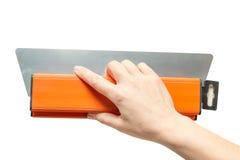 Kvinnlig hand med en spatel Arkivfoton