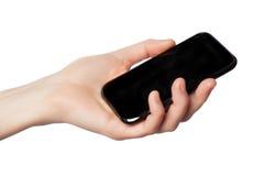 Kvinnlig hand med telefonen på en vit bakgrund Royaltyfria Foton