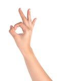 Kvinnlig hand på vit, ok tecken Royaltyfri Foto