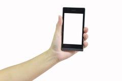 Kvinnlig hand som rymmer den moderna smarta telefonen med den vita skärmen på whit Royaltyfri Foto