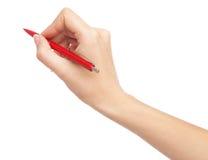 Kvinnlig handhandstil med en röd penna Royaltyfri Fotografi