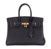 Kvinnlig handväska för naturligt läder arkivfoto