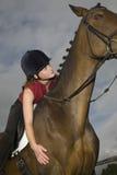Kvinnlig hästrygg Rider Sitting On Horse Arkivbilder