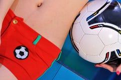 Kvinnlig huvuddel och fotboll Royaltyfri Foto