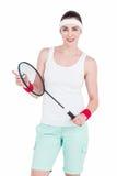 Kvinnlig idrottsman nen som spelar badminton Arkivbilder