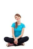 kvinnlig isolerad nätt sittande deltagare Fotografering för Bildbyråer